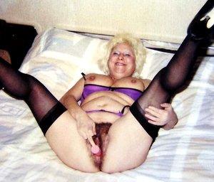 Hairy granny mature spreading her legs