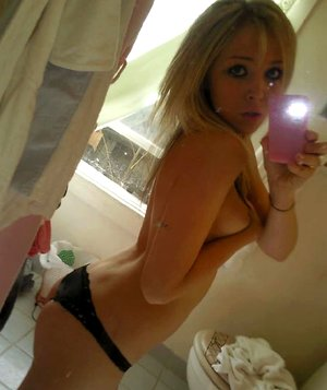 Kinky blonde teen stripping naked and posing sexy while camwhoring at home