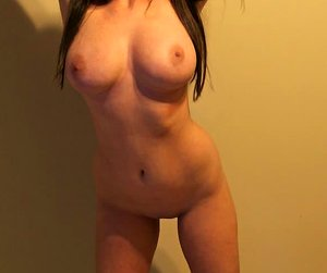 Heavy-chested amateur bombshell posing and teasing