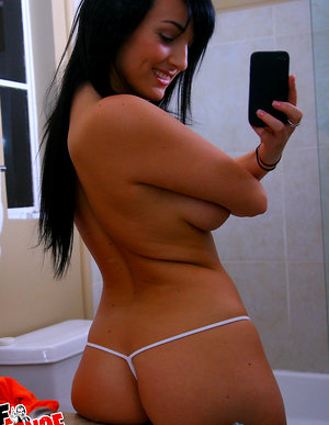 Watch this horny fucking babe get naked in the bathroom and fuck her box hot pics